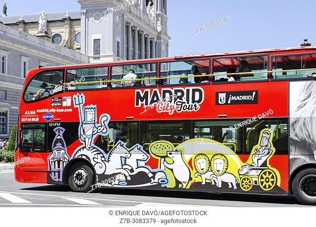 A touristic red bus view close to Palacio de Oriente. Madrid, Spain