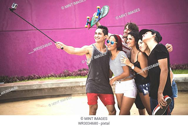 Group of young people posing for a selfie