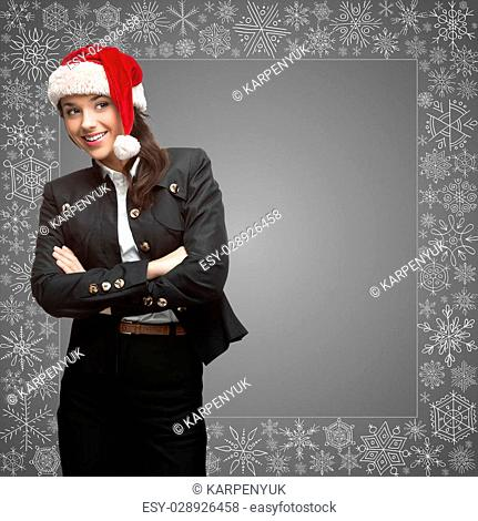 business woman in santa hat over gray background