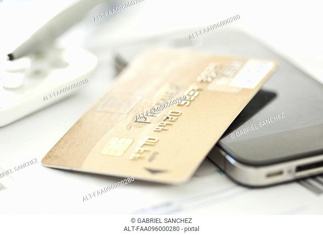 Close-up of credit card and smartphone