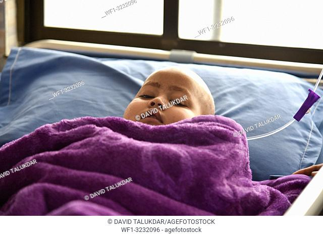 World Cancer Day. Guwahati, Assam, India. 4 February 2019. A Child Cancer patient on a bed at Dr. Bhubaneswar Borooah Cancer Institute and research centre in...