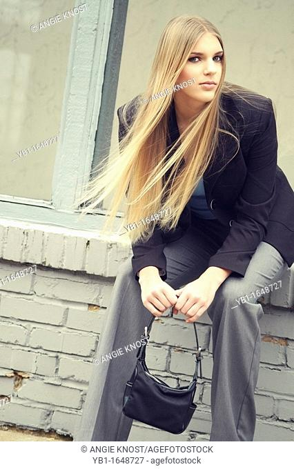 Fashion image of attractive woman with long blond hair  Photo has cross-process color effect