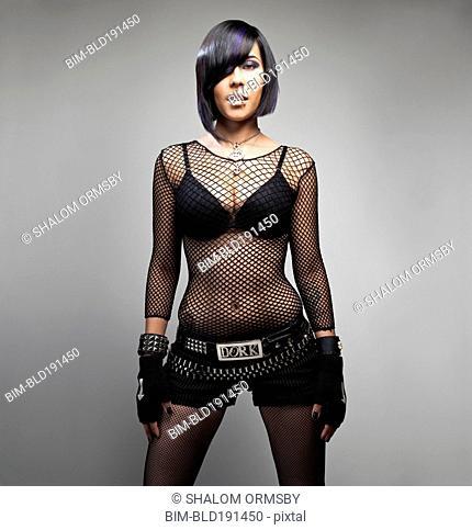 Sexy Hispanic woman in fishnet shirt