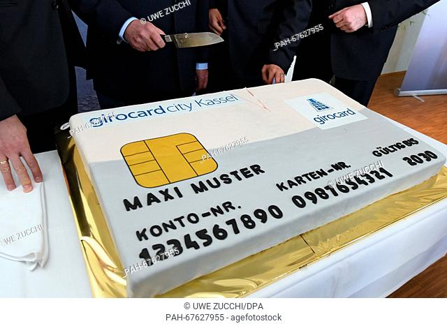 A large cake in the shape of the 'Girocard City' sits on a table at a press conference in Kassel, Germany, 20 April 2016