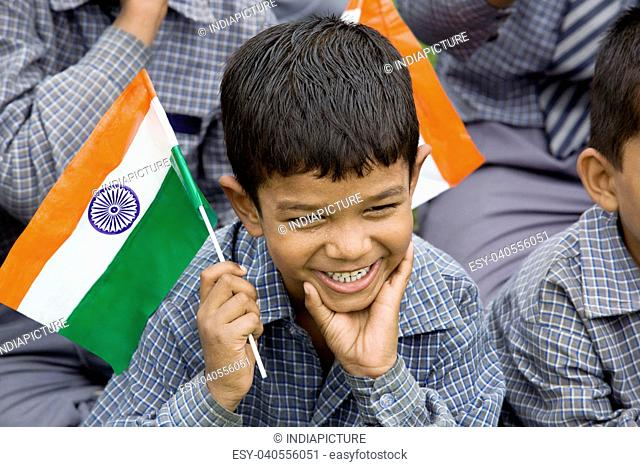School boy holding the Indian Flag