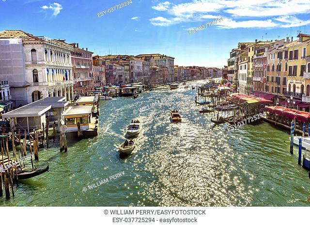 Colorful Grand Canal Public Ferries Vaporetto Ferry Docks Gondolas From Rialto Bridge Touirists Grand Canal Venice Italy