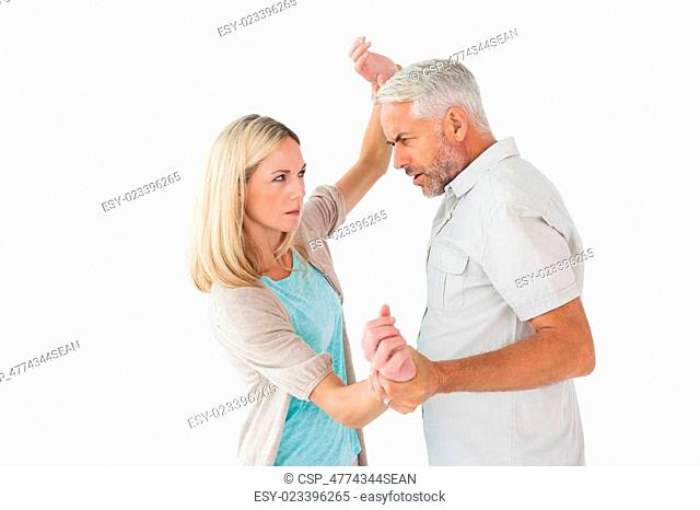 Angry man overpowering his partner