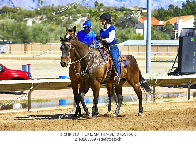 Parade of jockey's and their horses as they prepare for the race at Rillito Park track in Tucson AZ