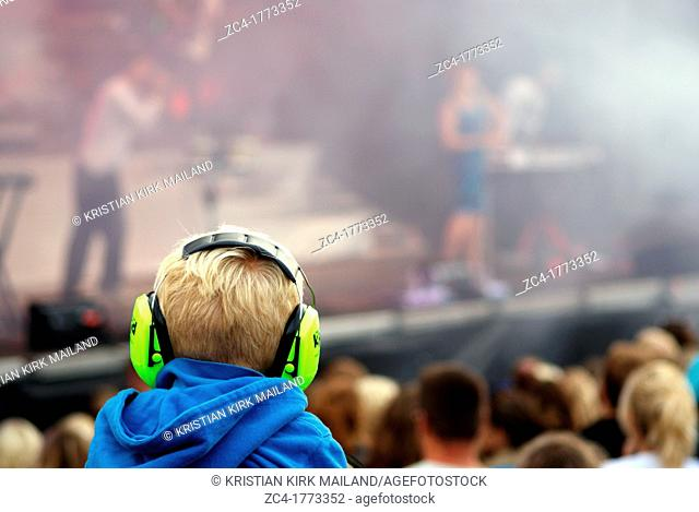 Loud music, protect your kids at rock concerts. Hammerhusfestival 2011 at Bornholm, Denmark