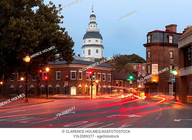 Evening traffic on Church Circle in Annapolis, Maryland creates streaks of light in front of the Maryland State House, opened in 1772