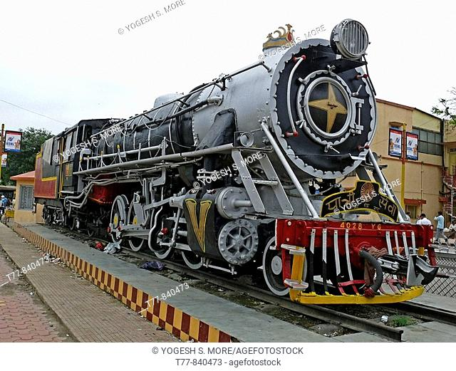Disused old steam engine outside Indore railway station kept for disply Indore, Madhyapradesh, India