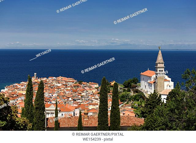 Piran Slovenia on Gulf of Trieste Adriatic sea the Punta lighthouse Cape Madonna St Clement church and St George's Cathedral belfry and baptistery