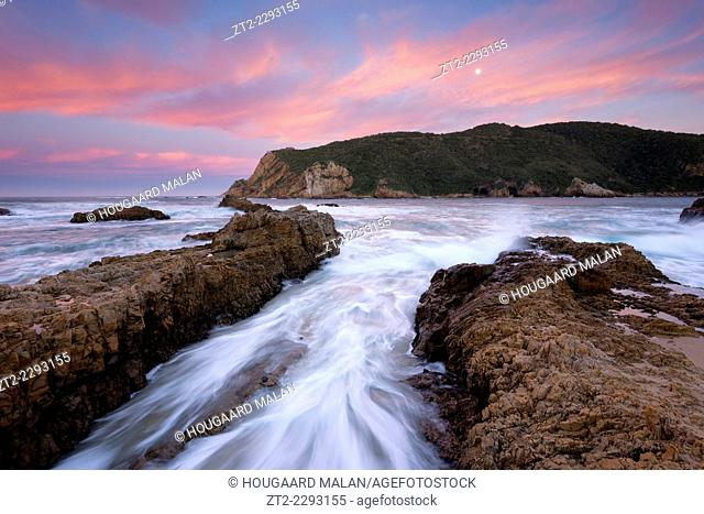 Landscape photo of a colourful sunrise sky over the rocks at the Knysna Heads.Knysna, Western Cape, South Africa