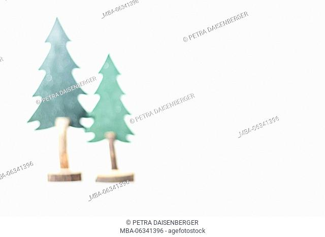 Christmas decoration, two Christmas trees made of wood, light background, blur