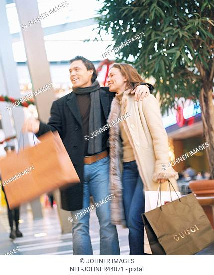 Man and woman shopping in the mall