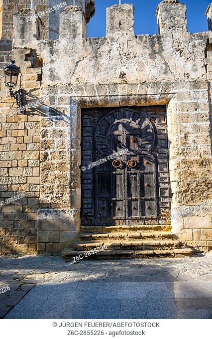 Entrance with wooden door to the San Marcos Castle in El Puerto de Santa Maria, province of Cádiz, Andalusia, Spain