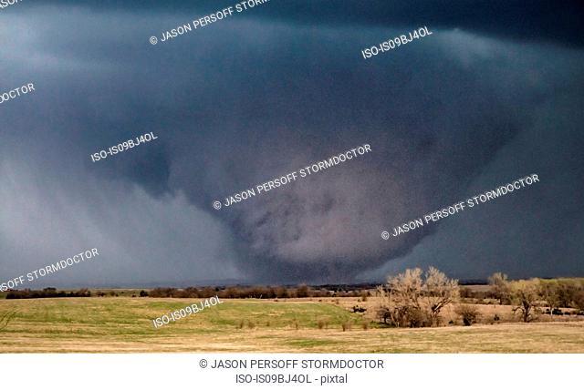 Violent tornado travels over plains, becoming a bowl shape, Tescott, Kansas, US