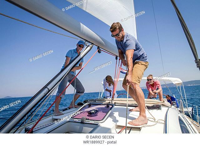 Two couples sailing together, Adriatic Sea, Croatia