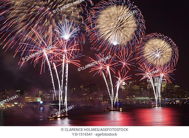The annual Macy's Fourth of July fireworks extravaganza lights the sky over the Hudson river on Monday, July 4, 2011 as seen from Weehawken
