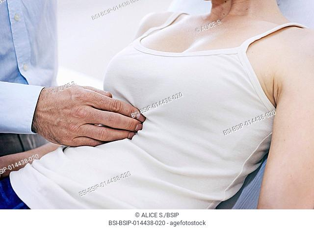 Doctor examining a patient's abdomen