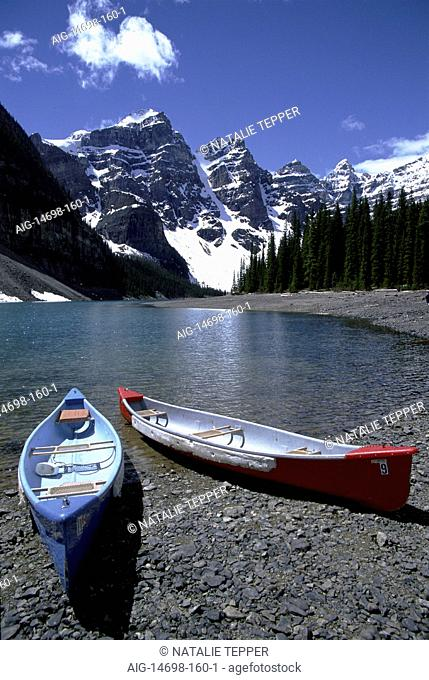 Canoes on the shore of a lake in Canada