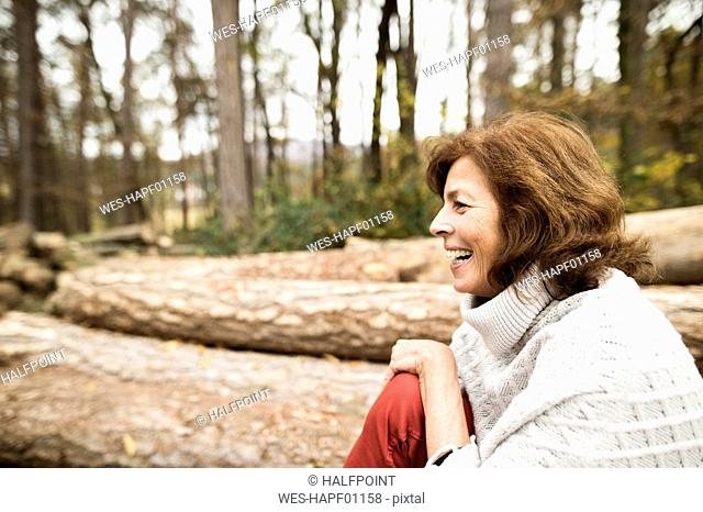 Laughing woman in autumnal nature
