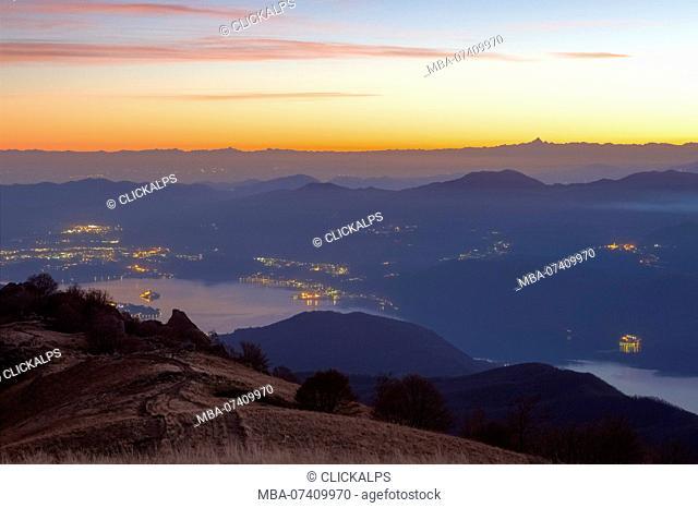 View of the Lago d'Orta, Isola di San Giulio and Monviso from the top of Mottarone. Stresa, Verbano Cusio Ossola, Piedmont, Italy