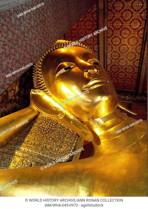 Wat Pho Buddhist temple in Phra Nakhon district, Bangkok, Thailand. Known as the Temple of the Reclining Buddha. The reclining Buddha is 15 m high and 43 m long...