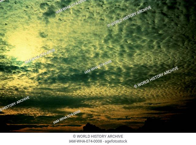 Photograph of Altocumulus cloud, a middle-altitude cloud genus that belongs to the stratocumuliform physical category. Photographed by Ralph F. Kresge