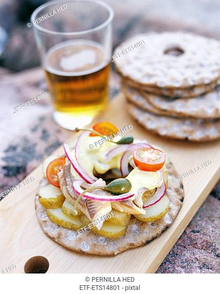 An open sandwich with herring and potatoes Sweden