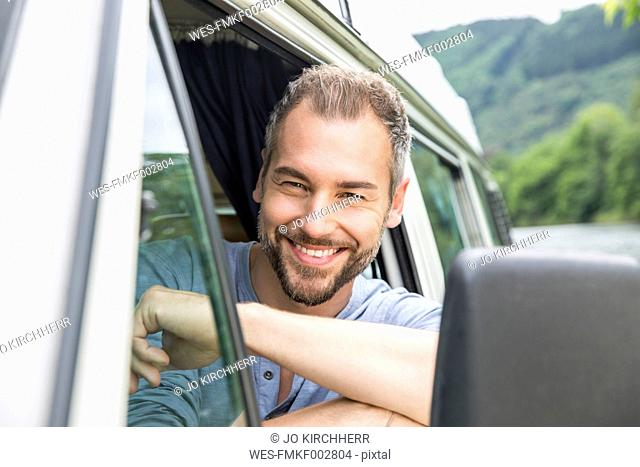 Portrait of smiling man in van