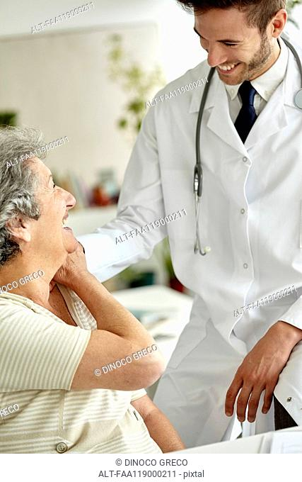 Doctor consoling senior woman