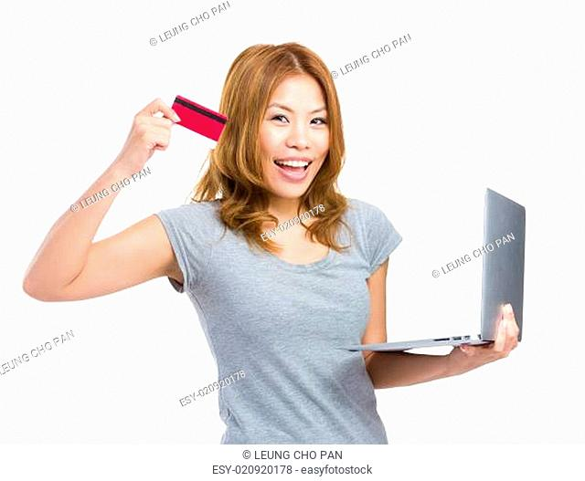 Woman using credit card for onling shopping