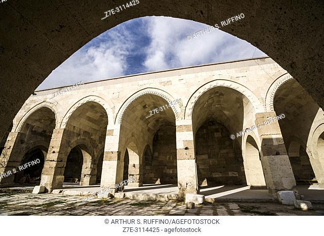 Courtyard colonnade with open chambers. Caravanserai of Agzikarahan, 13th century caravan inn for merchants, Cappadocia, Turkey