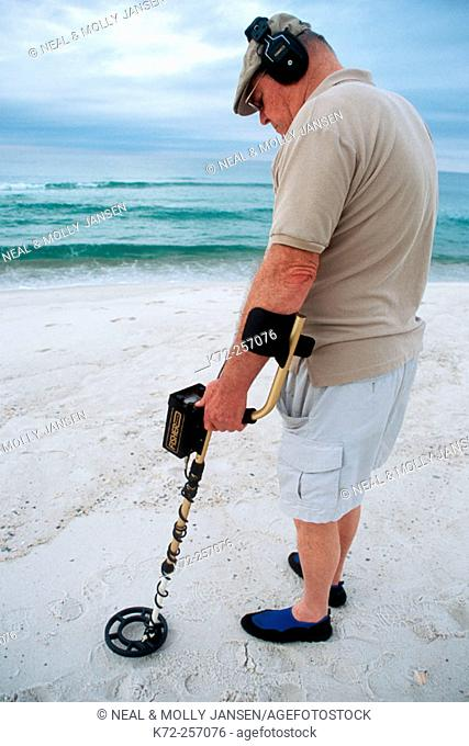 Man using metal detector. Panama City beach, Florida. USA