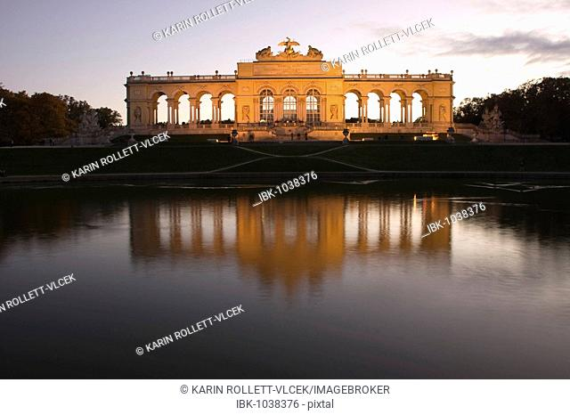 Illuminated gloriette with pond in the Schoenbrunn Palace Gardens, Vienna, Austria, Europe