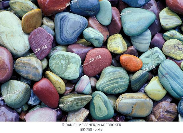 Colorful pebbles at the shore of McDonald Lake Glacier National Park Montana USA