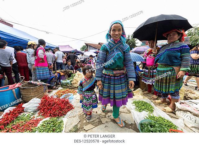 Hmong woman and girl at the Sunday market; Bac Ha, Lao Cai, Vietnam