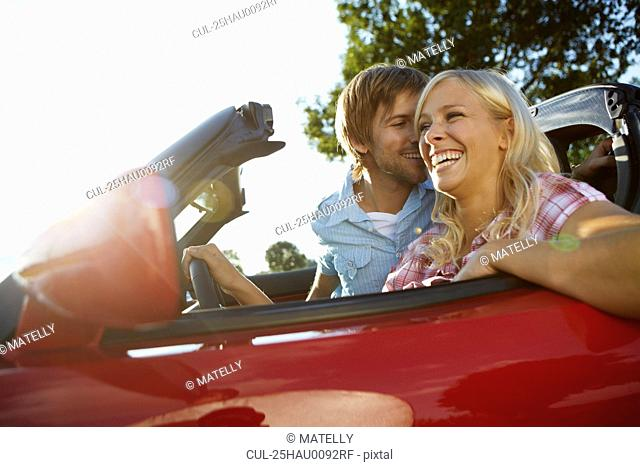 Couple sitting in their electric car