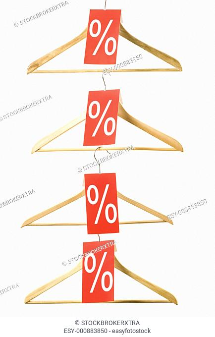 Image of wooden hangers with sale discount red checks on white background
