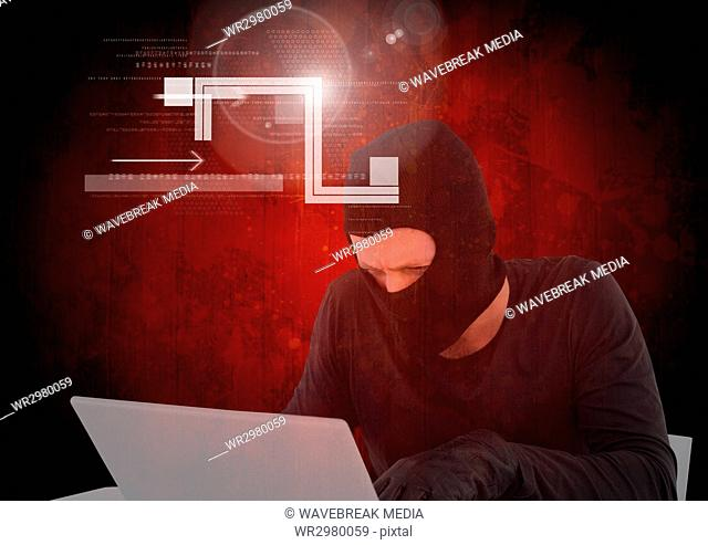 Hacker working on laptop in front of digital red background