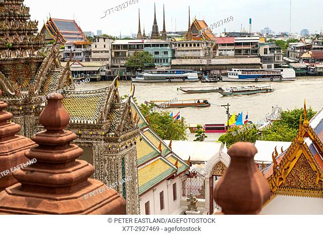 Looking across the Chao Phraya River towards the Grand Palace from Wat Arun temple complex. Yai district, Bangkok, Thailand