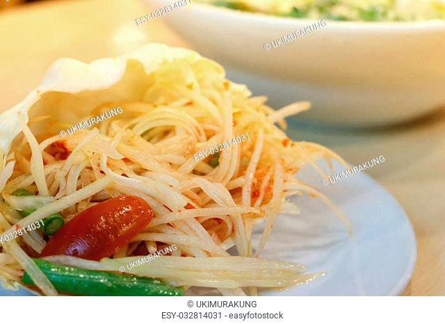 Papaya salad in cabbage or know as Som Tum in Thailand