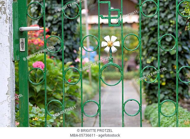 Wrought-iron garden door in the allotment garden