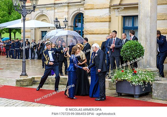 Queen Silvia of Sweden (2.f.L, blue dress), and the wife of Bavarian premier Seehofer, Karin Seehofer (C), are greeted by mayoress of Bayreuth Brigitte...
