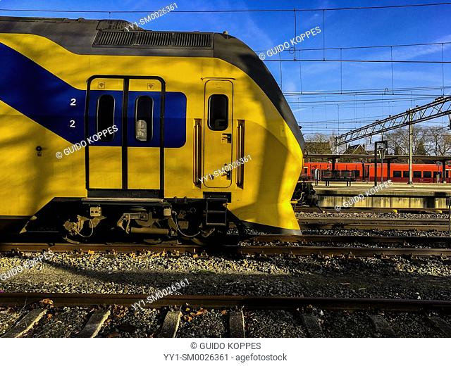 Dordrecht, Netherlands. Yellow, Blue & Black double deck intercity train parked near the Railway Station, waiting for it's next ride to it's new destination