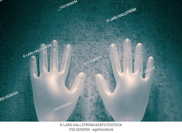 Latex gloves and stone background. Still life and symbol of hands working in healthcare. Protective medical supply