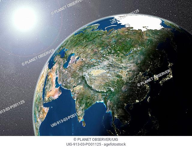 Globe Showing Asia, True Colour Satellite Image. True colour satellite image of the Earth showing Asia, half in shadow, and the sun