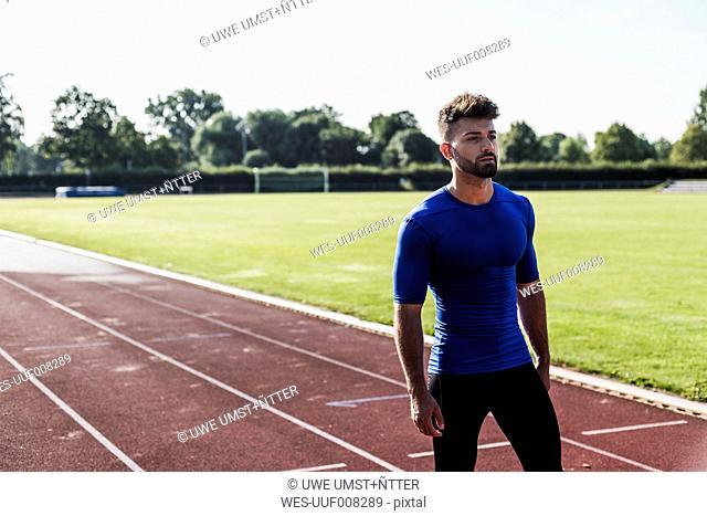 Athlete standing on tartan track