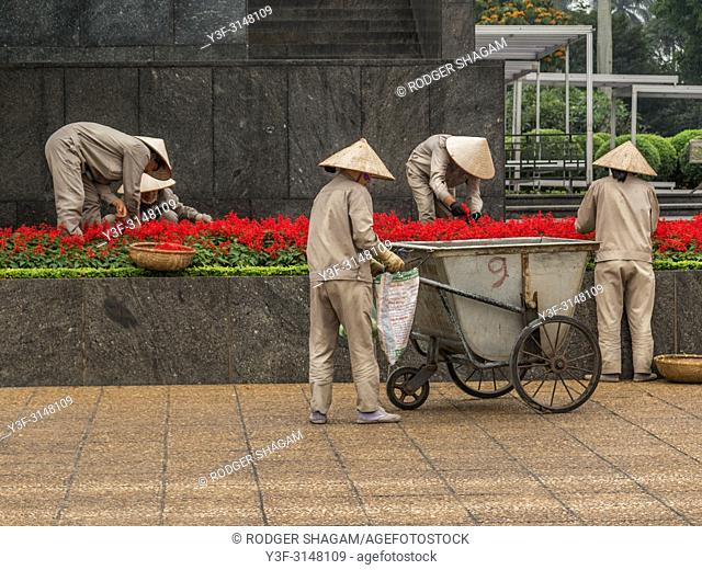 Gardeners working in the gardens in the Ho Chi Minh This style of hat is used primarily as protection from the sun and rain
